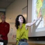 Kristy Leissle points to map of cocoa trade.